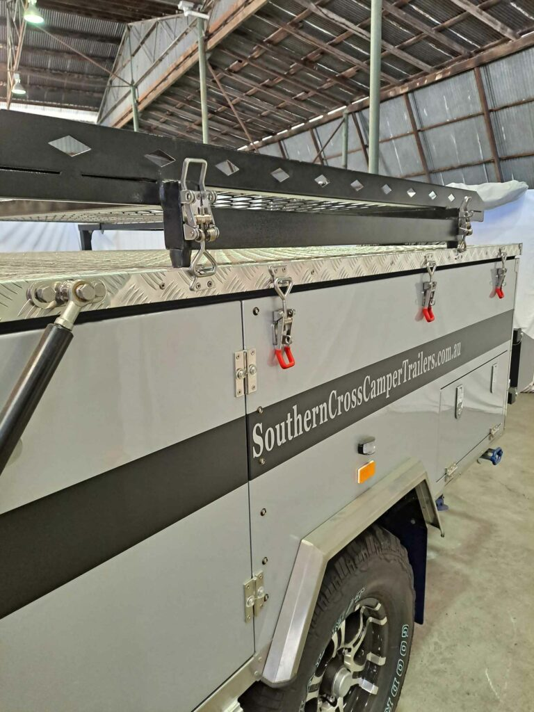 Photo showing Snap-Flat latches on Southern Cross camping trailer